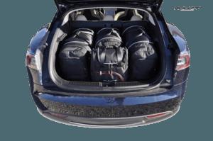 Foto: Maßgeschneiderte Reise-Autotaschen für das Tesla Model S (Set) von Kjust | © Kjust Carbags